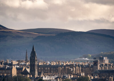 Edinburgh cityscape with hills in the background